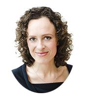 afbeelding van Caroline van Bemmel. Vrouw die de juiste keuzes toegankelijk maakt. Uiterlijk: donker bruine krullen, half lang haar, bruine ogen, een lach en sprankelende ogen.